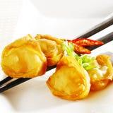 Fried wonton. On white background stock images