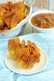Fried wontons. Deep fried wontons with peanut sauce Royalty Free Stock Images
