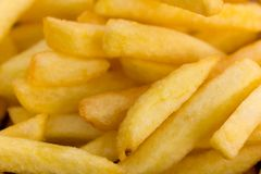 Fried,yellow french fries background Stock Image