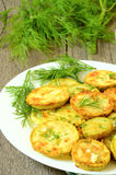 Fried zucchini with dill Stock Photos