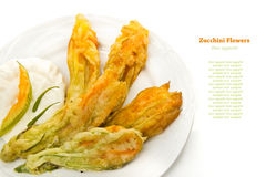 Fried zucchini flowers. With yogurt Royalty Free Stock Photography