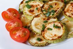 Fried zucchini with fresh cherry tomatoes. top view Stock Photo