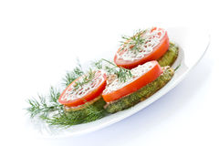 Fried zucchini with fresh tomatoes Royalty Free Stock Images