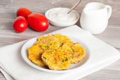 Fried zucchini fritters with dill on a plate Stock Images