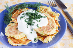 Fried zucchini fritters with sour cream Stock Photo