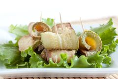 Fried zucchini  with lettuce leaves. Fried zucchini on a white plate with lettuce leaves Royalty Free Stock Images