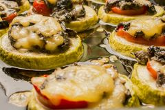 Fried zucchini with mushrooms tomato and cheese Royalty Free Stock Photo