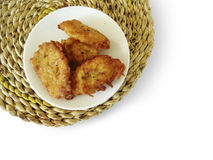Fried zucchini pancakes on a plate on a mat, isolated Stock Image