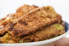 Fried zucchini on a plate lined for serving Stock Images