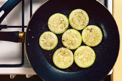 Fried zucchini slices prepared on a pan. Food photo royalty free stock images