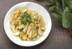 Fried Zucchini with tofu and egg put in white ceramic plate,vega royalty free stock image
