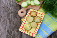 Fried zucchini in a yellow plate Stock Photos