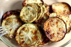 Fried zucchini. Yummy Fried zucchini cut on circles Royalty Free Stock Photography