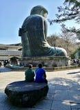 Frieden hinter dem Buddha Lizenzfreie Stockfotos