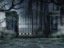 Friedhofstor mit Bäumen Stockbild