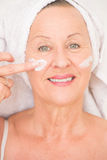 Friednly Mature Woman face moisturizer Stock Photography