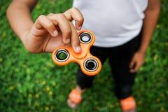 Friemel de spanning van de vingerspinner, het stuk speelgoed van de bezorgdheidshulp Stock Fotografie