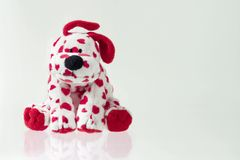 Friend. White doggy toy with heart pattern Royalty Free Stock Photo