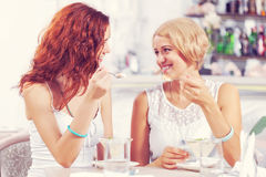 Friend chat at cafe Stock Images