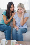 Friend comforting her crying friend Royalty Free Stock Photography