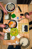 Friend cooking sushi roll at home Stock Images