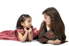 Friend on friend to eyes. Two girls to rest upon floor look friend on friend Stock Image
