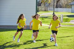 Friend girls teens playing football soccer in a park royalty free stock photo
