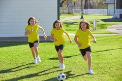 Friend girls teens playing football soccer in a park stock photos