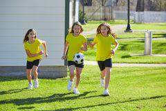 Friend girls teens playing football soccer in a park royalty free stock image