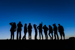 Friend groups silhouette. In sunrise stock photography