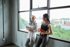 Friend at the gym chating in the break time. After exercising royalty free stock photo