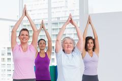 Friend with hands clasped exercising in gym Royalty Free Stock Photo