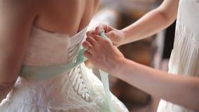 Friend Help the bride to wear a wedding dress stock footage