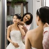 Friend helping bride. Stock Photo