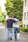 Friend helping brothers or patient  to walk without crutches Royalty Free Stock Photography