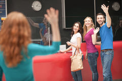 Friend� meeting at the cinema. Cheerful young people greeting their friend at the cinema box office Stock Photos