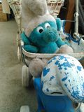 Friend from the past. Smurf stroller  at the flea market Stock Photography