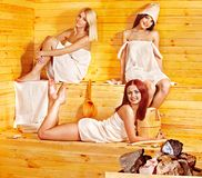 Friend relaxing in sauna. Stock Photos
