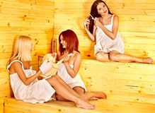 Friend relaxing in sauna. Royalty Free Stock Photography