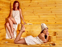 Friend relaxing in sauna Stock Images