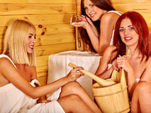 Friend relaxing in sauna Royalty Free Stock Photography