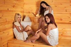 Friend relaxing in sauna Stock Image