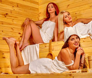 Friend relaxing in sauna. Royalty Free Stock Images
