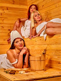 Friend relaxing in sauna. Royalty Free Stock Image