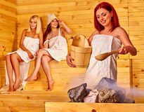 Friend relaxing in sauna Stock Photography