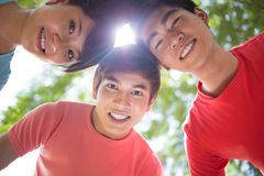 Friend's circle. Image of happy friends standing in a circle outside Stock Photos