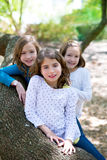Friend sister girls resting on tree trunk nature Royalty Free Stock Images