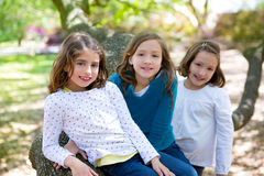 Friend sister girls resting on tree trunk nature Stock Photography