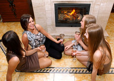 Friend sitting beside the fireplace Stock Photography