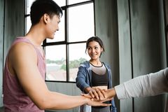 Gesture of sport shake hand in the gym stock photography